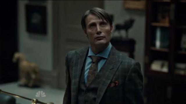 Dr. Hannibal Lecter (Mads Mikkelsen) with his stag statue behind him in his office.  I like to look for the stag.