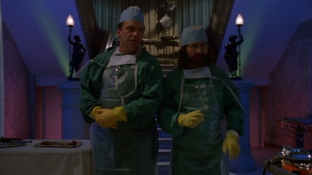 Tom Arnold and Tobe Hooper as morgue assistants.